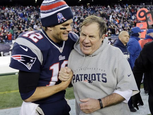 636216123419582578-ap-super-bowl-belichick-and-brady-football